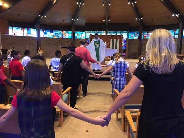2nd Graders Join Hands at Mass